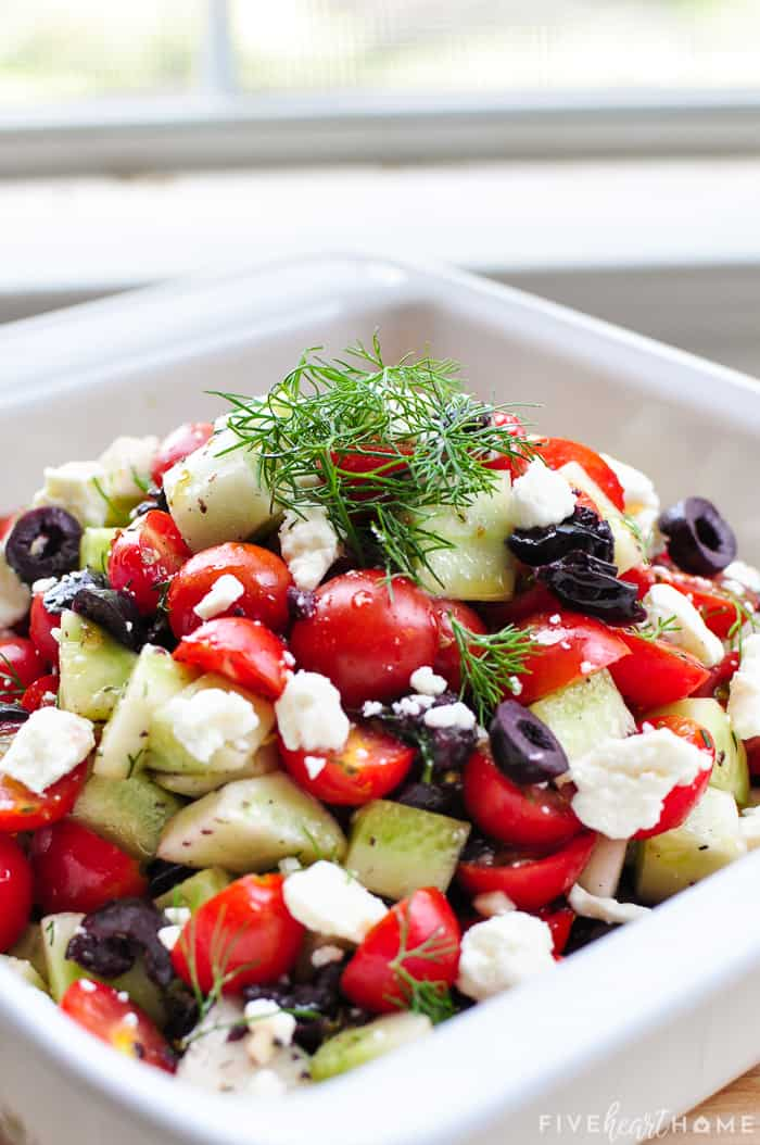 Recipe featuring black olives and dill in a serving bowl
