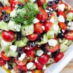 Tomato Cucumber Salad with Olives, Dill, & Feta ~ a perfect summer side dish recipe for using up an overabundance of garden fresh produce! | FiveHeartHome.com