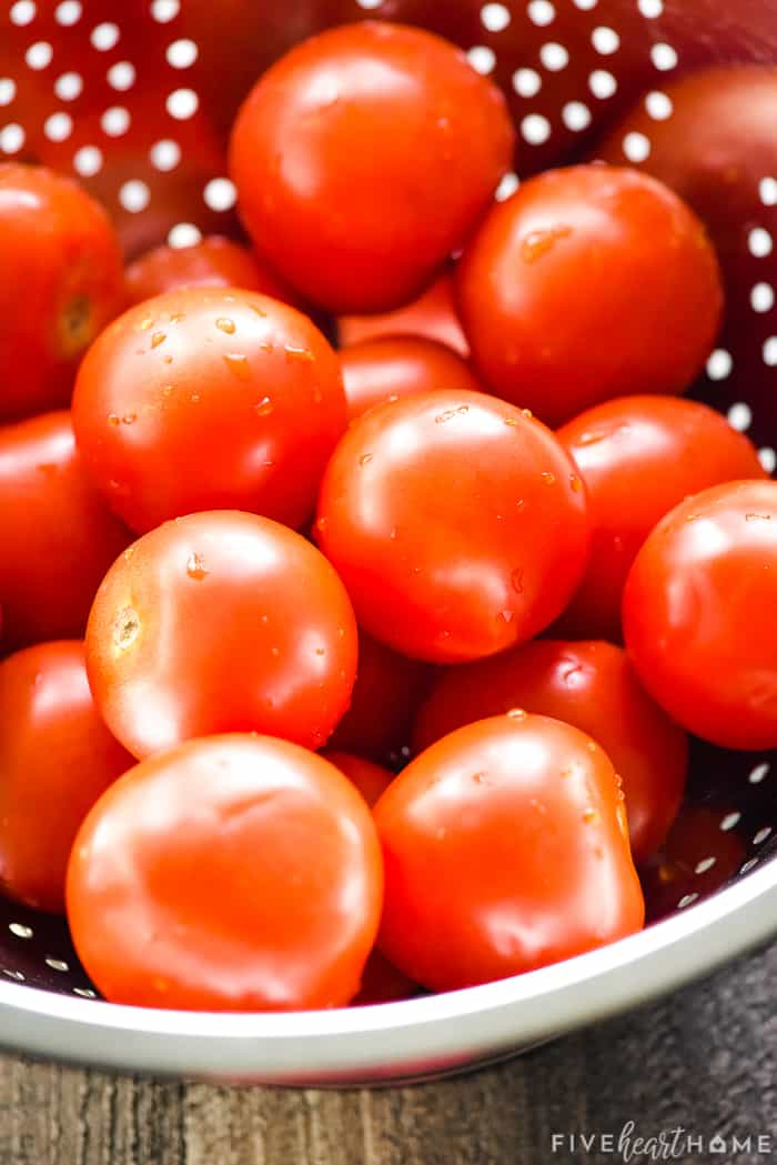 Colander of ripe tomatoes.