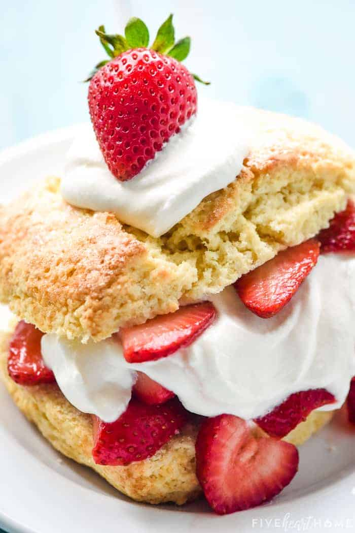 Strawberry Shortcake on a plate, zoomed in with strawberry on top