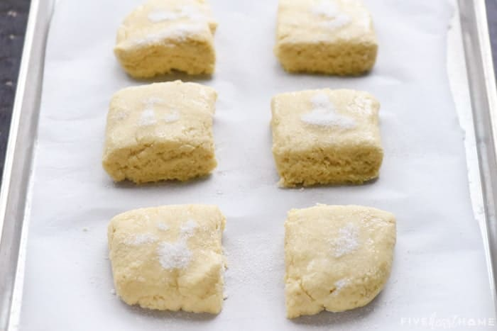 Unbaked shortcake squares on pan