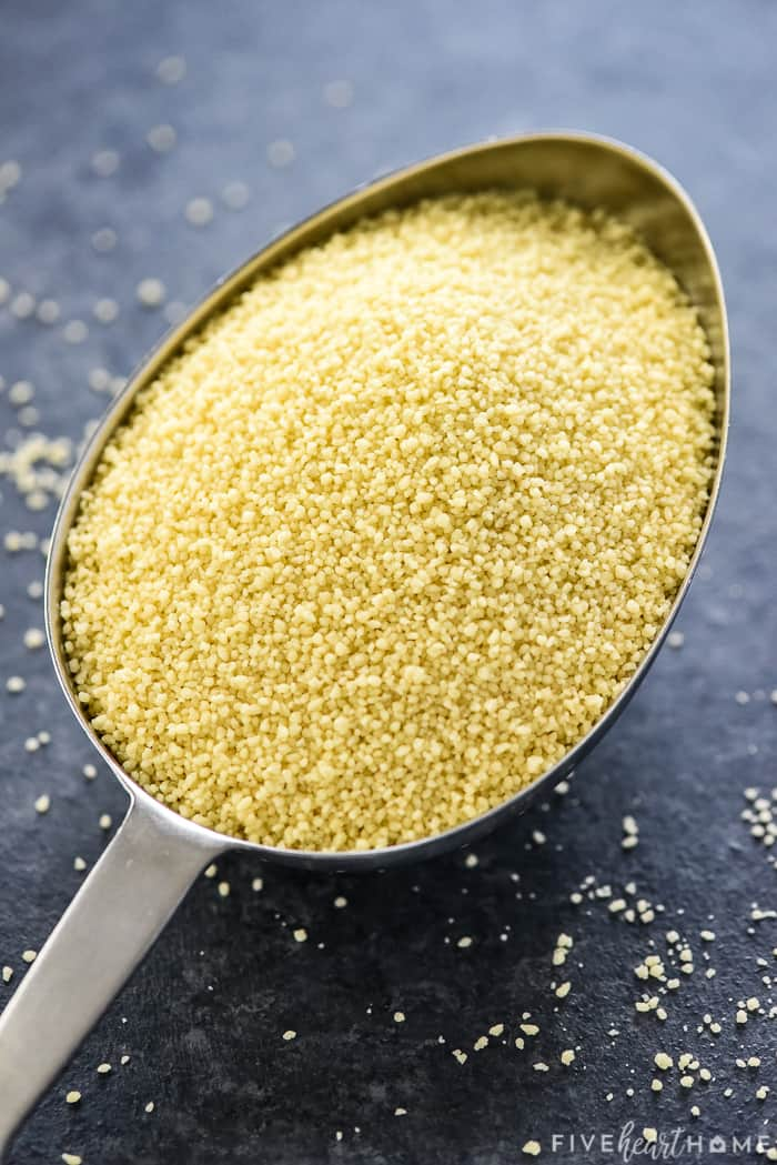 Uncooked couscous in measuring scoop