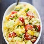 Summer Couscous Salad ~ a flavorful side dish featuring fluffy couscous studded with fresh corn, juicy tomatoes, crisp cucumbers, sweet peaches, chopped basil, and creamy feta in a honey lime dressing! | FiveHeartHome.com #couscous #couscoussalad #couscousrecipe #summersalad