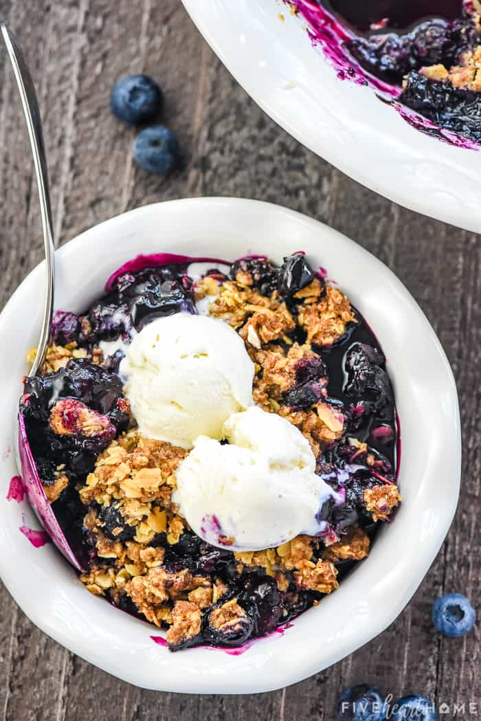 Blueberry Crisp in a bowl with ice cream on top