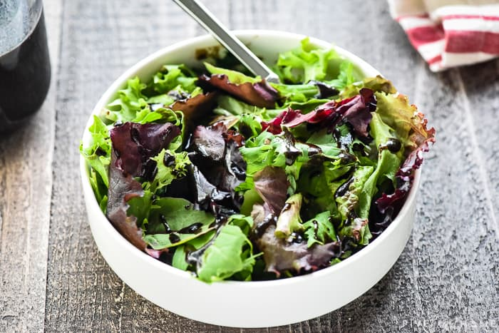 Balsamic dressing drizzled over salad.