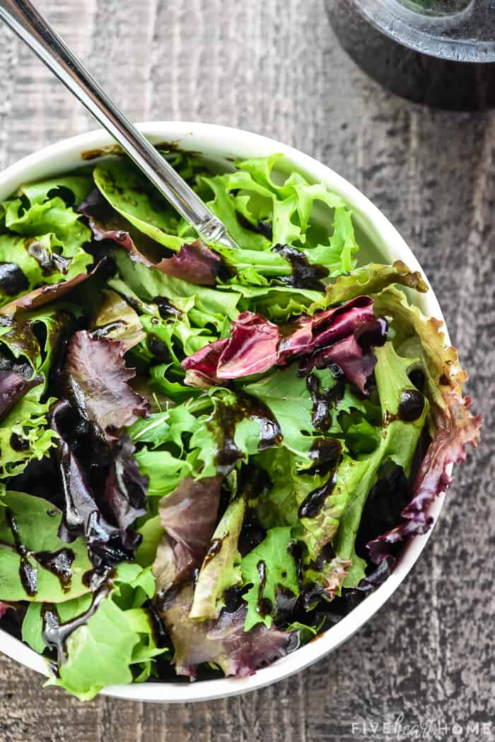 Balsamic Vinaigrette drizzled over a salad.