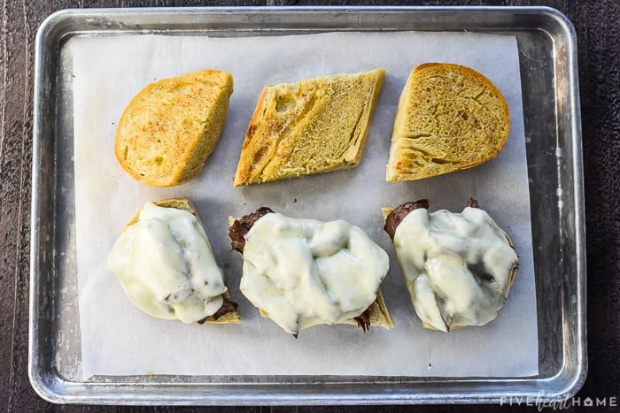 Sandwiches on baking sheet with melted cheese