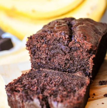 Triple Chocolate Banana Bread ~ moist, fudgy, and loaded with three kinds of chocolate, making this banana bread recipe a mouthwatering, delicious way to use up overripe bananas! | FiveHeartHome.com