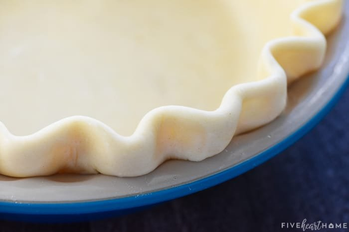 Fluted edge of Butter Pie Crust ready to go into oven.