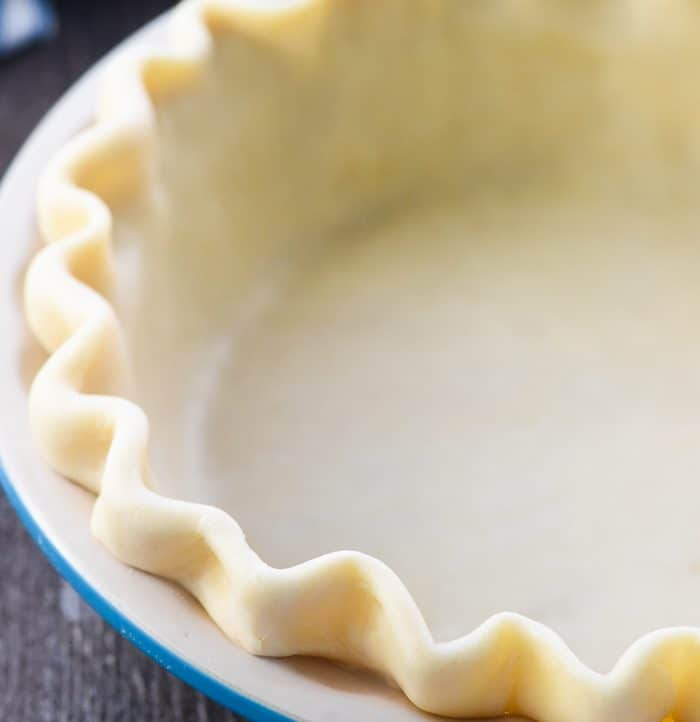 Butter Pie Crust ~ this flaky, tender, all-butter pie crust is THE BEST! It's unbelievably EASY to make from scratch with a few tricks and tips and just FOUR ingredients. In fact, it's so simple and delicious that you'll never buy a pre-made pie crust again! | FiveHeartHome.com #piecrust #butterpiecrust #piecrustrecipe