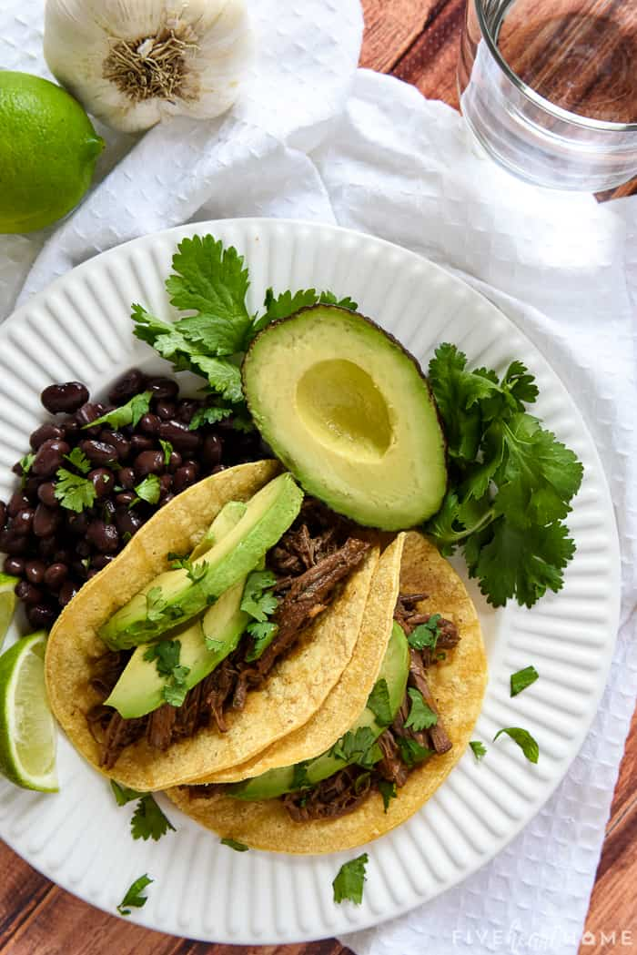 Barbacoa tacos on a plate, aerial view
