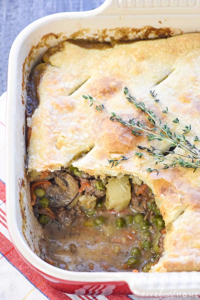 Beef Pot Pie in dish with a missing scoop.