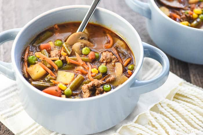 Bowl of beef and vegetables with spoon
