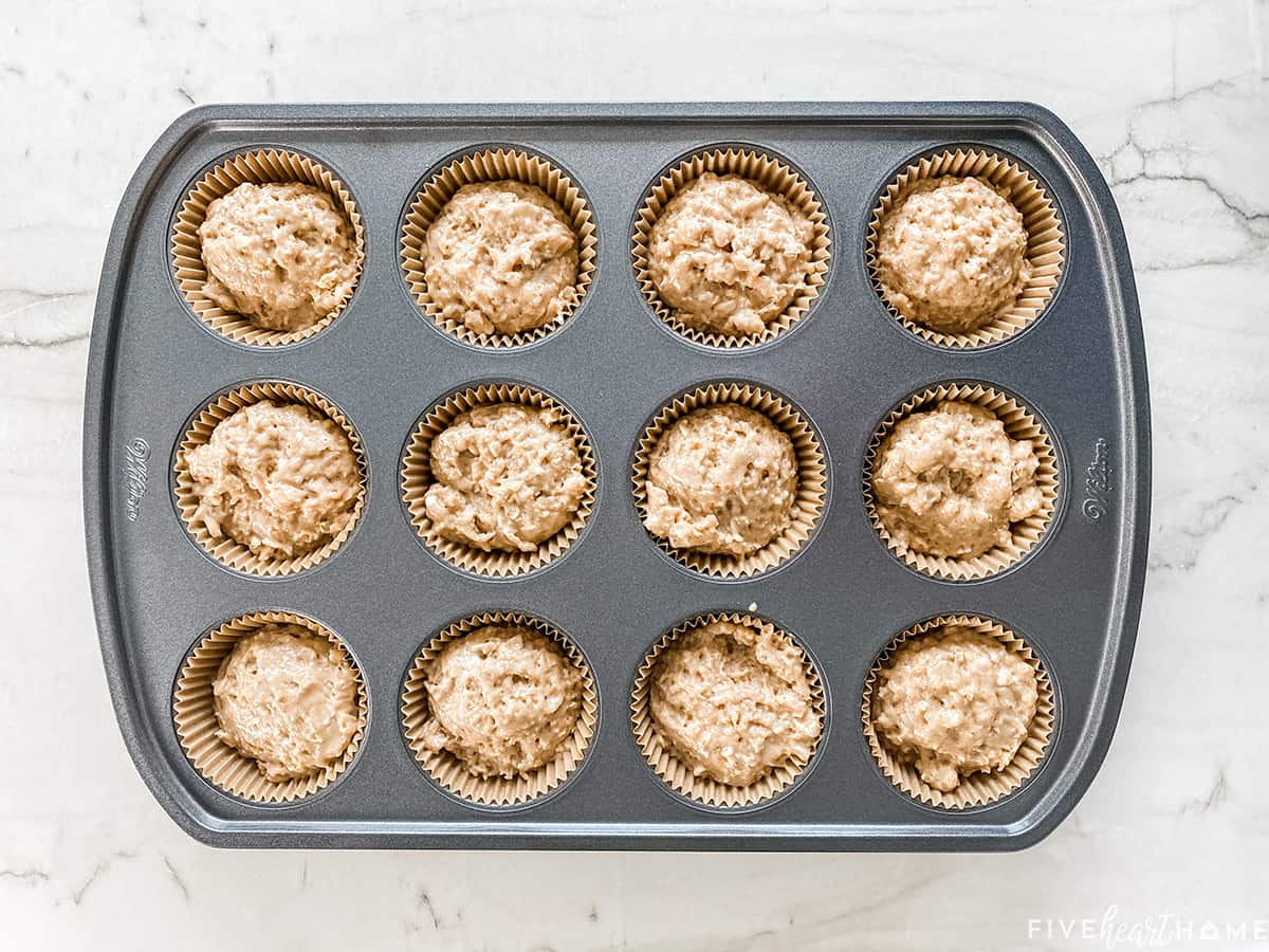 Aerial view of muffin pan with oatmeal muffin recipe batter.