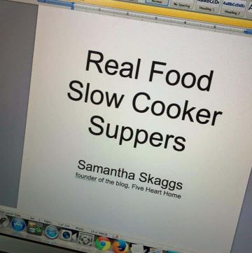 """Laptop screen showing this wording: """"Real Food Slow Cooker Suppers"""" by """"Samantha Skaggs, founder of the blog, Five Heart Home"""""""