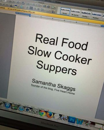 "Laptop screen showing this wording: ""Real Food Slow Cooker Suppers"" by ""Samantha Skaggs, founder of the blog, Five Heart Home"""