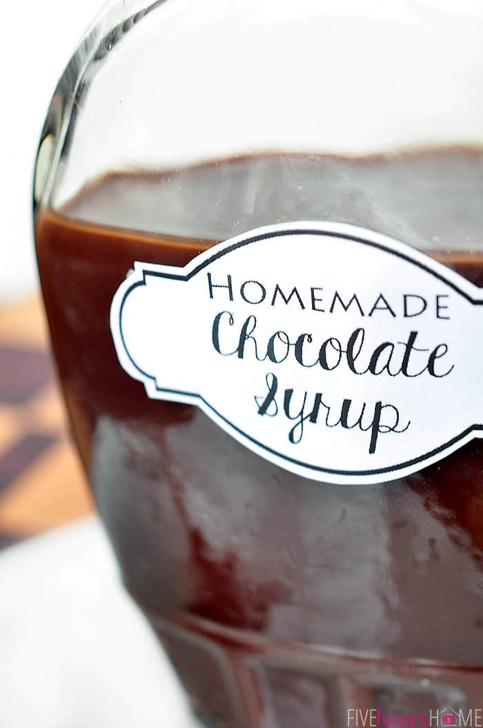 close-up of Homemade Chocolate Syrup in a glass bottle with a white label on front