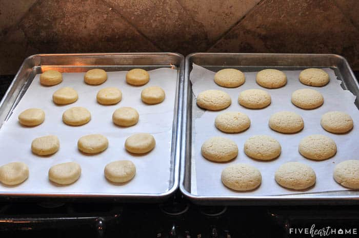 Two side-by-side baking pans lined with parchment paper and cookies, unbaked on left and baked on right.