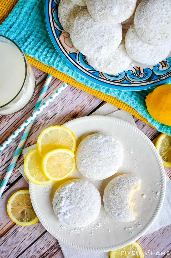 Aerial view of Lemon Cooler Cookies on plates with lemon slices.