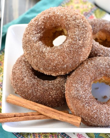 Baked Apple Cider Donuts piled on plate.