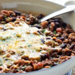 Chili Mac recipe in skillet topped with melted cheese.