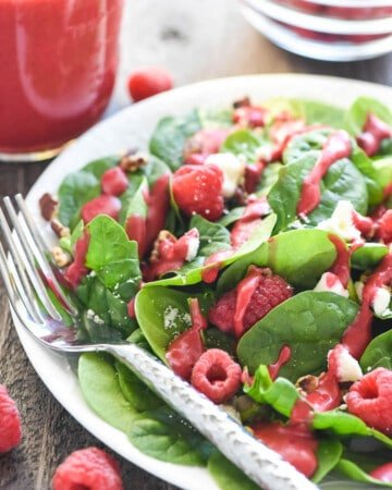 Green salad topped with raspberries, nuts, feta, and Raspberry Vinaigrette.