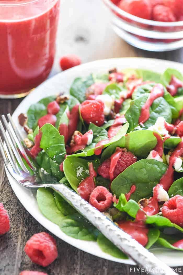 Green salad topped with raspberries, nuts, feta, and Raspberry Vinaigrette.