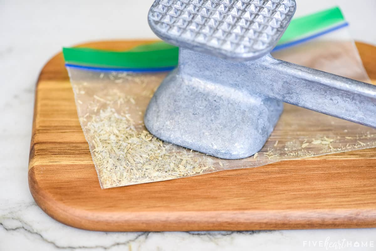 How to crush fennel seeds with a mallet.