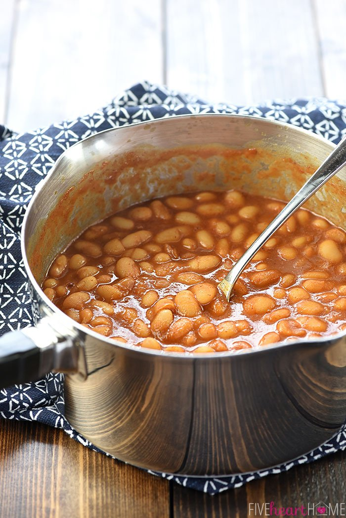 Quick Stovetop Baked Beans in a pot with a spoon.