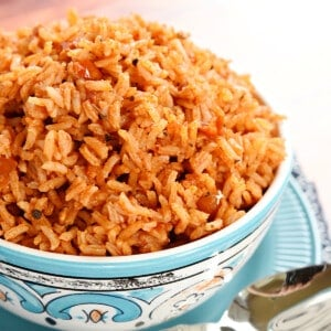 Spanish Rice piled up in blue and white serving bowl.