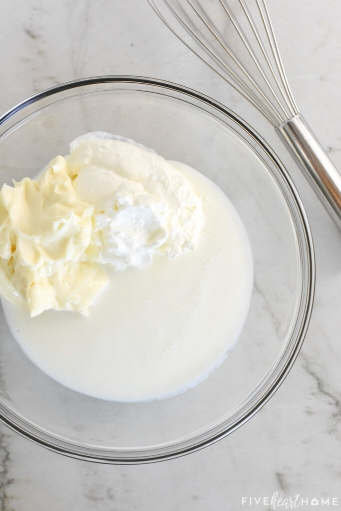 Buttermilk, mayonnaise, and sour cream in glass bowl.
