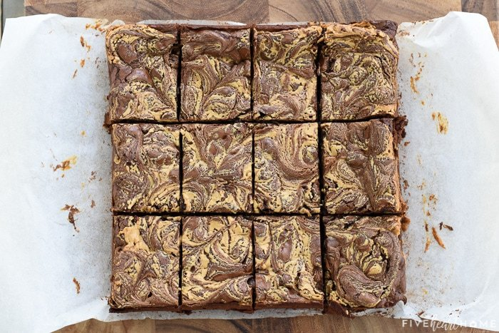 Aerial view of gluten-free Peanut Butter Brownies on parchment paper cut into bars.