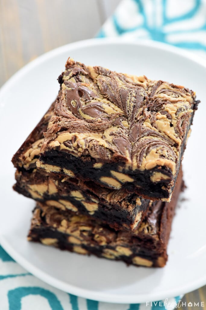 Close-up fo stack of Peanut Butter Brownies on plate.