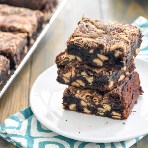 Peanut Butter Brownies stacked on a white plate.
